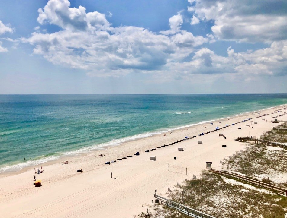 View of Orange Beach, Alabama on a sunny day with beach goers